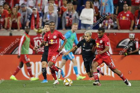 New York Red Bulls midfielder Cristian Casseres Jr. (23) competes for the ball with D.C. United midfielder Lucas Rodriguez (11) during an MLS soccer match, in Harrison, N.J. The final score was a 0-0 draw