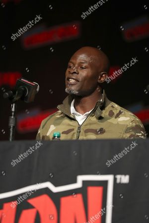 """Djimon Hounsou speaks on stage during the 20th Century Fox Panel: An Insider's Look at """"The King's Man"""" and """"Free Guy"""" on the first day of New York Comic Con, in New York"""