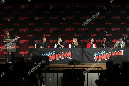 "From left, Terri Schwartz, Shawn Levy, Ryan Reynolds, Jodie Comer, Joe Keery, Utkarsh Ambudkar, and Lil Rel Howery speak on stage during the 20th Century Fox Panel: An Insider's Look at ""The King's Man"" and ""Free Guy"" on the first day of New York Comic Con, in New York"