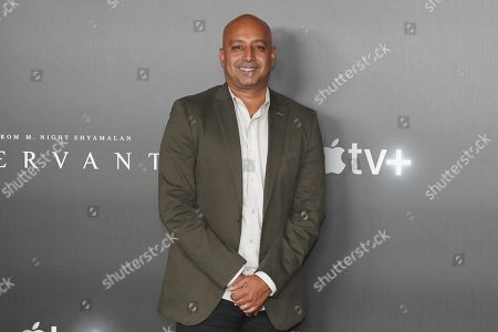 "Ashwin Rajan poses for a photo before the ""A Night with M. Night: Introducing Servant on Apple TV+"" panel at Hammerstein Ballroom on the first day of New York Comic Con, in New York"
