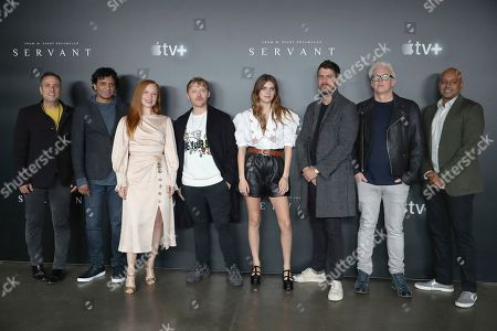 "From left, Jason Blumenthal, M. Night Shyamalan, Lauren Ambrose, Rupert Grint, Nell Tiger Free, Toby Kebbell, Tony Basgallop, and Ashwin Rajan pose for a photo before the ""A Night with M. Night: Introducing Servant on Apple TV+"" panel at Hammerstein Ballroom on the first day of New York Comic Con, in New York"