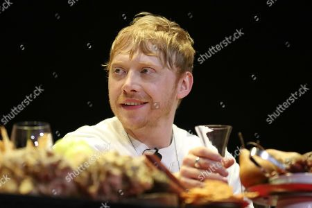 "Rupert Grint smiles on stage during the ""A Night with M. Night: Introducing Servant on Apple TV+"" panel at Hammerstein Ballroom on the first day of New York Comic Con, in New York"
