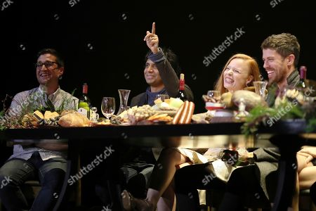 """M. Night Shyamalan, center left, makes a comment while Josh Horowitz, Lauren Ambrose, and Toby Kebbell react during the """"A Night with M. Night: Introducing Servant on Apple TV+"""" panel at Hammerstein Ballroom on the first day of New York Comic Con, in New York"""