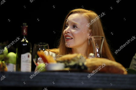 """Lauren Ambrose reacts on stage during the """"A Night with M. Night: Introducing Servant on Apple TV+"""" panel at Hammerstein Ballroom on the first day of New York Comic Con, in New York"""