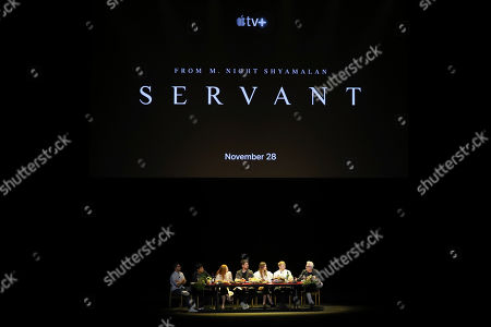 "From left, Josh Horowitz, M. Night Shyamalan, Lauren Ambrose, Toby Kebbell, Nell Tiger Free, Rupert Grint, and Tony Basgallop participate in the ""A Night with M. Night: Introducing Servant on Apple TV+"" panel at Hammerstein Ballroom on the first day of New York Comic Con, in New York"