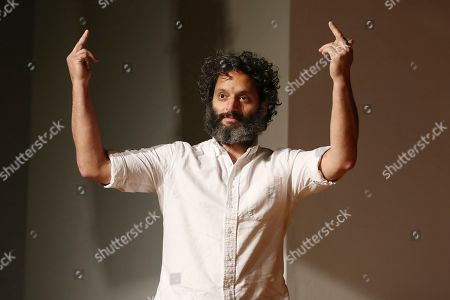 """Jason Mantzoukas walks on stage during the """"Netflix Presents: Big Mouth"""" panel at the Javits Center on the first day of New York Comic Con, in New York"""