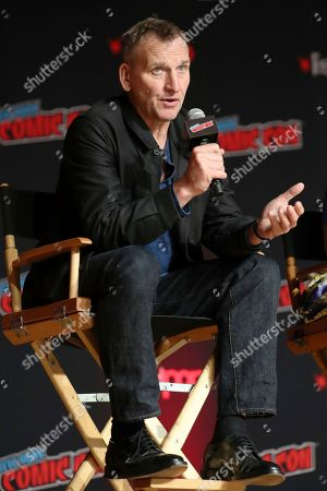 "Christopher Eccleston speaks during the ""Fantastic! A Conversation with Christopher Eccleston"" panel on the first day of New York Comic Con, in New York"