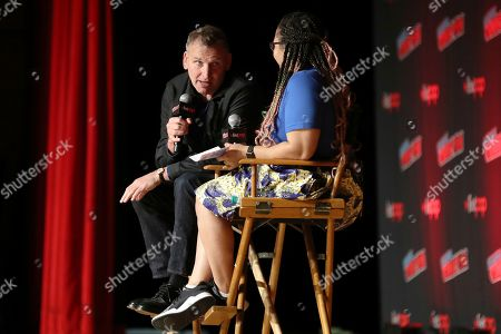 "Christopher Eccleston, left, speaks with Constance Gibbs during the ""Fantastic! A Conversation with Christopher Eccleston"" panel on the first day of New York Comic Con, in New York"