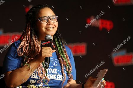 "Constance Gibbs moderates the ""Fantastic! A Conversation with Christopher Eccleston"" panel on the first day of New York Comic Con, in New York"