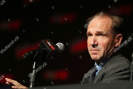 "Ralph Fiennes speaks on stage during the 20th Century Fox Panel: An Insider's Look at ""The King's Man"" and ""Free Guy"" on the first day of New York Comic Con, in New York"