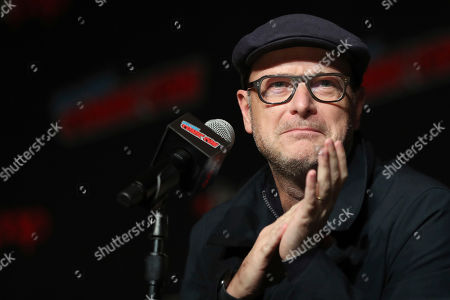 """Matthew Vaughn speaks on stage during the 20th Century Fox Panel: An Insider's Look at """"The King's Man"""" and """"Free Guy"""" on the first day of New York Comic Con, in New York"""