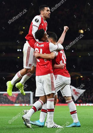 Stock Photo of Gabriel Martinelli (R) of Arsenal celebrates with teammates Reiss Nelson (C) and Dani Ceballos after scoring during the UEFA Europa League match between Arsenal London and Standard Liege in London, Britain, 03 October 2019.