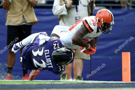 Cleveland Browns wide receiver Jarvis Landry (80) is tackled just shy of the goal line by Baltimore Ravens defensive back DeShon Elliott (32) during the third quarter of an NFL football game, in Baltimore. Landry, who did not return to the game after that play, remains in concussion protocol following the game in which he caught eight passes for a career-high 167 yards in Sunday's 40-25 victory. Coach Freddie Kitchens said Thursday that Landry is still out, and it's not yet known if he'll be available Monday night when the Browns (2-2) visit the San Francisco 49ers (3-0). Landry has also been returning punts this season