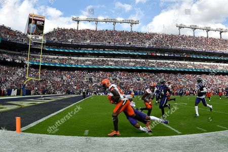 Cleveland Browns wide receiver Jarvis Landry (80) tries to score as Baltimore Ravens defensive back DeShon Elliott makes the tackle in the third quarter of an NFL football game in Baltimore. Landry, who did not return to the game after that play, remains in concussion protocol following the game in which he caught eight passes for a career-high 167 yards in Sunday's 40-25 victory. Coach Freddie Kitchens said Thursday that Landry is still out, and it's not yet known if he'll be available Monday night when the Browns (2-2) visit the San Francisco 49ers (3-0). Landry has also been returning punts this season