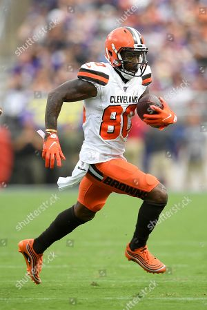 Cleveland Browns wide receiver Jarvis Landry runs with the ball against the Baltimore Ravens during the third quarter of an NFL football game Sunday in Baltimore. Landry, who did not return to the game after that play, remains in concussion protocol following the game in which he caught eight passes for a career-high 167 yards in Sunday's 40-25 victory. Coach Freddie Kitchens said Thursday that Landry is still out, and it's not yet known if he'll be available Monday night when the Browns (2-2) visit the San Francisco 49ers (3-0). Landry has also been returning punts this season