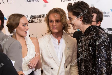 Lily-Rose Depp, Tom Glynn-Carney, Timothee Chalamet. Actors Lily-Rose Depp, Tom Glynn-Carney centre, and Timothee Chalamet chat with one another as they pose for photographers upon arrival at the premiere of the 'The King' which is screened as part of the London Film Festival, in central London