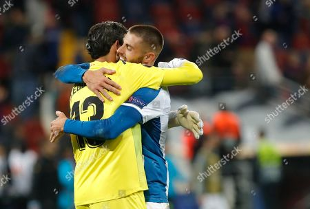 Espanyol's goalkeeper Diego Lopez, left, and Espanyol's David Lopez celebrate their victory at the end of Europa League group H soccer match between CSKA Moscow and Espanyol at CSKA Arena in Moscow, Russia