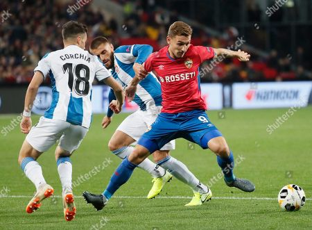 Sebastien Corchia (L) and David Lopez (C) of RCD Espanyol in action against Fedor Chalov (R)  of CSKA during UEFA Europa League group stage match in Moscow, Russia, 03 October 2019.