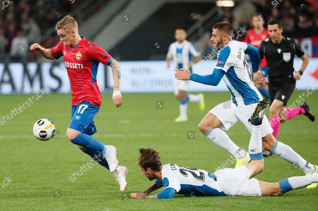Fernando Calero (C, down) and  David Lopez (R) of RCD Espanyol in action against Fedor Chalov (L) of CSKA during UEFA Europa League group stage match in Moscow, Russia, 03 October 2019.