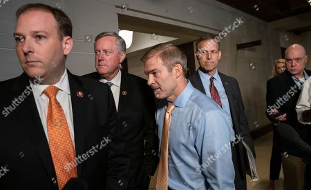 Lee Zeldin, Mark Meadows, Jim Jordan, Scott Perry. Conservative Republican lawmakers, from left, Rep. Lee Zeldin R-N.Y., Rep. Mark Meadows, R-N.C., Rep. Jim Jordan, R-Ohio, ranking member of the Committee on Oversight Reform, and Rep. Scott Perry, R-Pa., speak briefly to reporters before returning to a closed-door briefing with Kurt Volker, a former special envoy to Ukraine, as House Democrats proceed with the impeachment investigation of President Donald Trump, at the Capitol in Washington