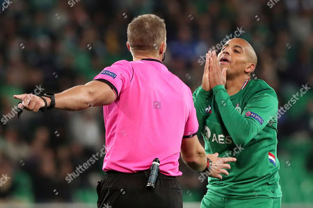 Saint-Etienne's Wahbi Khazri, right, reacts during the Europa League group I soccer match between Saint-Etienne and VfL Wolfsburg at the Geoffroy Guichard stadium, in Saint-Etienne, central France