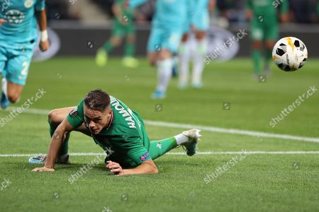 Saint-Etienne's Romain Hamouma looks the ball as he lays down on the field during the Europa League group I soccer match between Saint-Etienne and VfL Wolfsburg at the Geoffroy Guichard stadium, in Saint-Etienne, central France