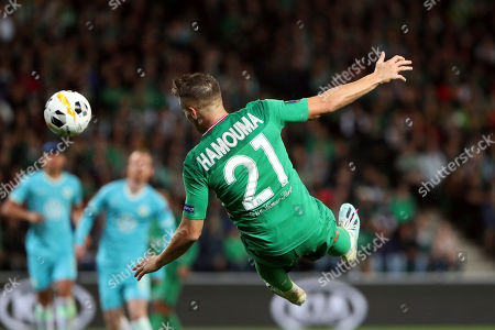 Saint-Etienne's Romain Hamouma heads the ball during the Europa League group I soccer match between Saint-Etienne and VfL Wolfsburg at the Geoffroy Guichard stadium, in Saint-Etienne, central France