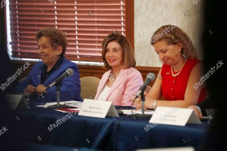 Speaker of the Rep. House Nancy Pelosi, D-Calif., center, joins local officials Debbie Wasserman Schultz, right, and Representative Donna Shalala, left, to speak about Venezuelan democracy efforts, in Weston, Fla