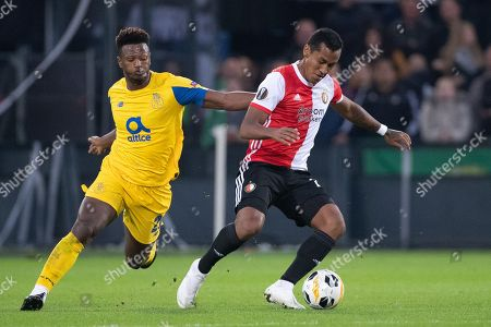 Ze Luis of Porto FC duels with Renato Tapia of Feyenoord Rotterdam (R) during the UEFA Europa League group G match Feyenoord Rotterdam vs FC Porto in Rotterdam, The Netherlands, 03 October 2019.