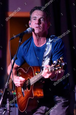 Stock Picture of Dennis Quaid performs at the after party for the Brent Sopel Annual Celebrity Golf Tournament at the Quarry Pub & Grill, in Chicago