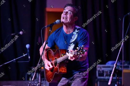 Stock Image of Dennis Quaid performs at the after party for the Brent Sopel Annual Celebrity Golf Tournament at the Quarry Pub & Grill, in Chicago