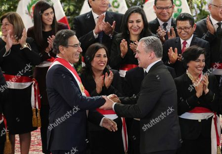 Martin Vizcarra, Salvador del Solar. Peru's President Martin Vizcarra, left, shakes hands with Peru's former Prime Minister Salvador del Solar after a swearing-in ceremony of his new cabinet, at the government palace in Lima, Peru,. The president and his new ministers will rule Peru without the congress that was dissolved on Monday