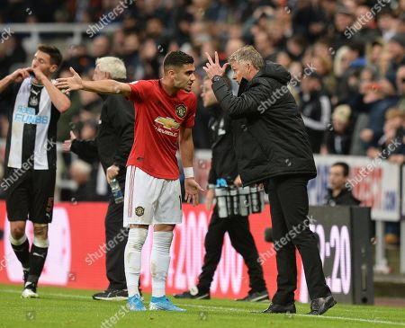 Stock Image of Manchester United manager Ole Gunnar Solskjaer gets in a heated debate with Andreas Pereira of Manchester United after conceding a goal to Newcastle United