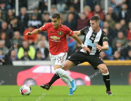Andreas Pereira of Manchester United fends off Ciaran Clark of Newcastle United