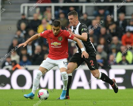 Stock Photo of Andreas Pereira of Manchester United fends off Ciaran Clark of Newcastle United