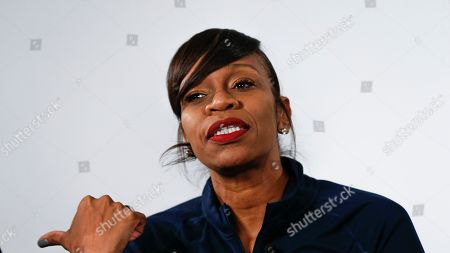 Virginia women's basketball coach Tina Thompson answers a question during the Atlantic Coast Conference women's NCAA college basketball media day in Charlotte, N.C