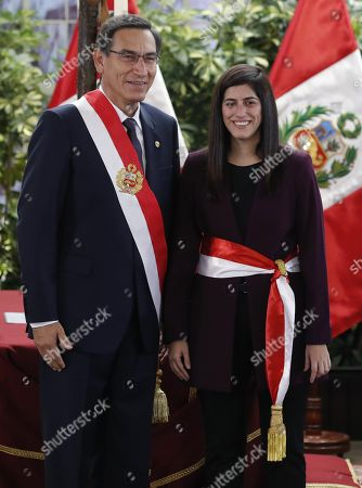 Stock Photo of Peruvian President Martin Vizcarra (L) poses next to the new Minister of Economy and Finances Marti Antonieta Alva Luperdi (R) at the Government Palace in Lima, Peru, 03 October 2019. Alva Luperdi was sworn into office together with the other members of the new cabinet, in the midst of the country's political crisis over the dissolution of Parliament by Vizcarra.