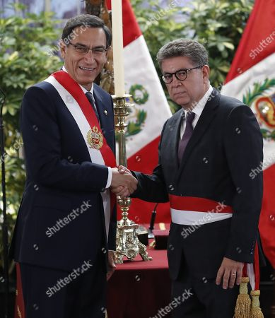 Peruvian President Martin Vizcarra (L) greets new Foreign Minister Gustavo Meza Cuadra during the inauguration ceremony at the Government Palace in Lima, Peru, 03 October 2019. Gustavo Meza Cuadra was sworn into office together with the other members of the new cabinet, in the midst of the country's political crisis over the dissolution of Parliament by Vizcarra.