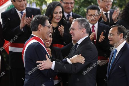 Stock Image of Peruvian President Martin Vizcarra (L) greets former prime minister Salvador del Solar (R) during the inauguration ceremony of the new cabinet of ministers at the Government Palace in Lima, Peru, 03 October 2019. Members of the new cabinet were sworn into office in the midst of the country's political crisis over the dissolution of Parliament by Vizcarra.