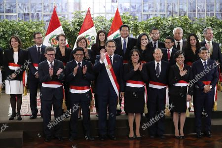 Peruvian President Martin Vizcarra (C) poses next to his new cabinet during their inauguration ceremony at the Government Palace in Lima, Peru, 03 October 2019. Members of the new cabinet were sworn into office in the midst of the country's political crisis over the dissolution of Parliament by Vizcarra.