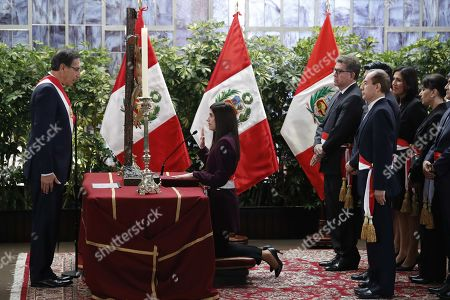 Peruvian President Martin Vizcarra (L) swears-in new Minister of Economy and Finances Marti Antonieta Alva Luperdi (C) at the Government Palace in Lima, Peru, 03 October 2019. Alva Luperdi was sworn into office together with the other members of the new cabinet, in the midst of the country's political crisis over the dissolution of Parliament by Vizcarra.