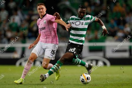 LASK's Reinhold Ranftl, left, vies for the ball with Sporting's Yannick Bolasie during the Europa League group D soccer match between Sporting CP and LASK at the Alvalade stadium in Lisbon