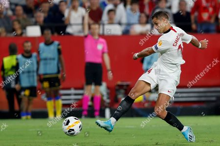 Sevilla's Javier Hernandez shoots, but fails to score during the Europa League group A soccer match between Sevilla and APOEL Nicosia at the Estadio Ramon Sanchez-Pizjuan stadium in Seville, Spain