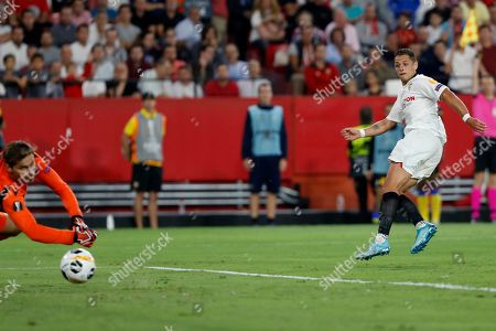 Stock Photo of Sevilla's Javier Hernandez shoots, but fails to score during the Europa League group A soccer match between Sevilla and APOEL Nicosia at the Estadio Ramon Sanchez-Pizjuan stadium in Seville, Spain