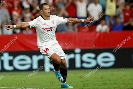 Sevilla's Javier Hernandez celebrates after scoring his side's opening goal during the Europa League group A soccer match between Sevilla and APOEL Nicosia at the Estadio Ramon Sanchez-Pizjuan stadium in Seville, Spain