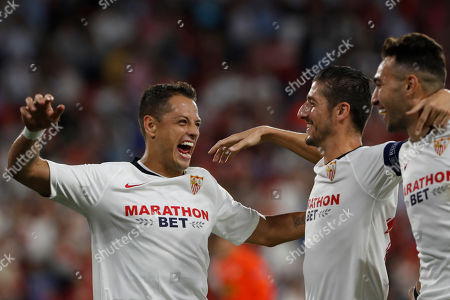 Sevilla's Javier Hernandez, left, celebrates with teammates after scoring his side's opening goal during the Europa League group A soccer match between Sevilla and APOEL Nicosia at the Estadio Ramon Sanchez-Pizjuan stadium in Seville, Spain