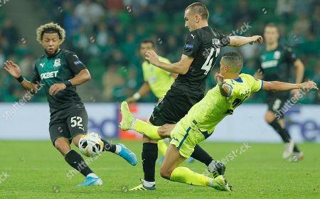 Tonny Vilhena (L) and Daniil Utkin (C) of Krasnodar in action against Faycal Fajr (R) of Getafe during the Europe League Group C match between FC Krasnodar and Getafe CF at the Stadium Krasnodar in Krasnodar, Russia, 03 October 2019.