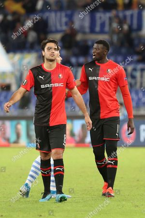 Rennes' Clement Grenier, left, and Rennes' M'Baye Niang leave the pitch at the end of the Europa League Group E soccer match between Lazio and Rennes, at Rome's Olympic Stadium, . Lazio beat Rennes 2-1