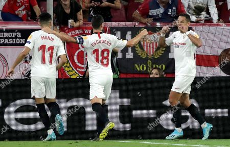 Sevilla FC's Javier 'Chicharito' Hernandez (R) celebrates with teammates Munir El Haddadi (L) and Sergio Escudero after scoring during during the UEFA Europa League Group A soccer match between Sevilla FC and Apoel FC at the Sanchez Pizjuan stadium in Seville, Spain, 03 October 2019.