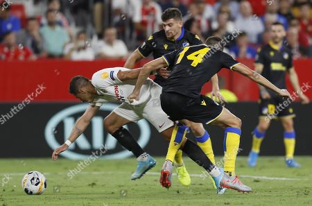 Sevilla FC's 'Chicharito' Hernandez (L) in action against Apoel's Uros Matic (C) during the UEFA Europa League Group A soccer match between Sevilla FC and Apoel FC at the Sanchez Pizjuan stadium in Seville, Spain, 03 October 2019.